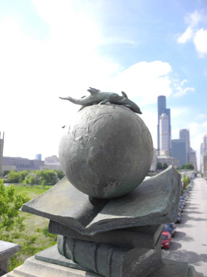 Walking back: globe on a bridge.  Hancock tower is in the background. That is the second tallest building in Chicago, and what we aim for when we're lost and need to get back to campus.