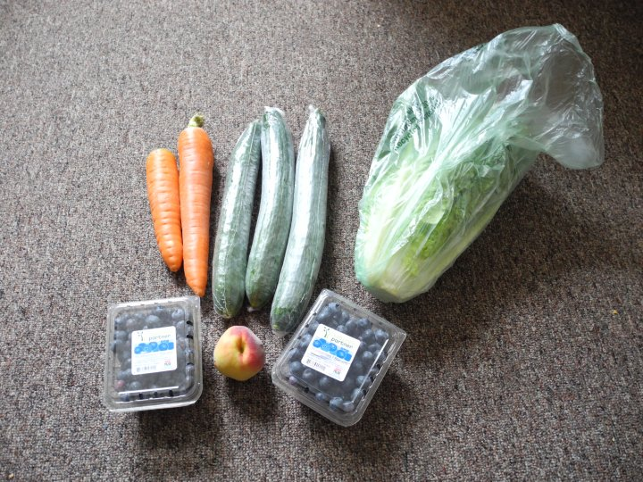 Romaine lettuce, two big carrots, three cucumbers, a peach, and two things of blueberries for under $4!